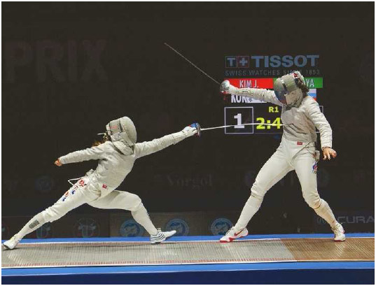 Kim Ji-yeon of Korea lunges at Sofya Velikaya of Russia at the Moscow Sabre Grand Prix, May 2015. The goal of fencing is to bring your weapon into contact with some part of your opponent's body, without being touched yourself.