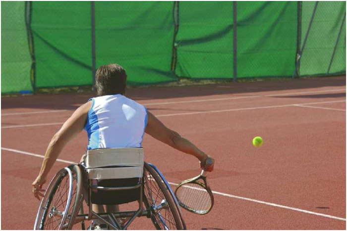 A man in a wheelchair stays active by playing tennis. Physical activity is important for individuals of all ages and abilities, helping to maintain muscle strength and a healthy weight.