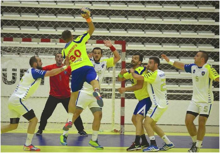 A Romanian handball player takes a shot during a European Handball Federation EURO Cup 2018 qualifying match against Kosovo, October 2014.