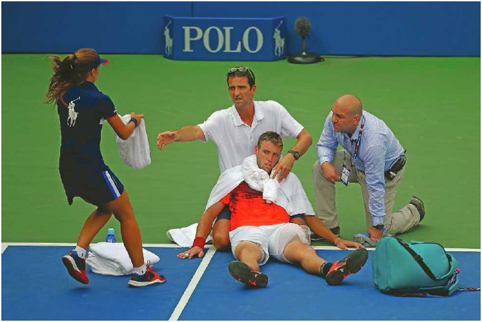 U.S. tennis player Jack Sock receives medical attention due to heat exhaustion during the U.S. Open in Queens, New York, September 2015. Heat exhaustion can quickly progress into heatstroke, an even more serious illness that can be fatal.