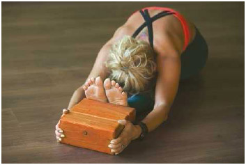 In iyengar yoga, tools like wooden blocks are used to help students achieve the traditional asanas (poses) and improve strength and flexibility.