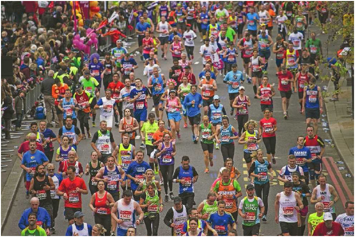 Runners compete in the London Marathon, April 2015. A marathon is a 26.2-mile footrace that requires plenty of preparation by incorporating a range of running exercises, cross-training exercises, and a healthy diet.