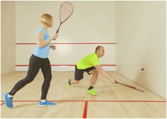 A man and woman play a game of racquetball. As racquetball is a highly aerobic sport, participants should have healthy muscles and joints and condition their cardiovascular system with plenty of aerobic exercise before playing.