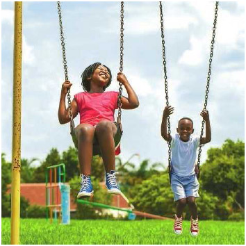Children playing on a swing set. Recess and unstructured play allow children to establish their own activities on the playground, providing an opportunity for imaginative thinking as well as a refreshing break from formal classroom structure.