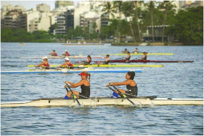 Teams of rowers race on Rodrigo de Freitas Lagoon in Rio de Janeiro, Brazil, April 2016. Rowing is primarily a competitive sport in which participants need great strength and endurance.