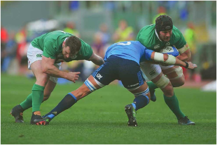 A forward from team Italy attempts to tackle team Ireland's ballcarrier during the Royal Bank of Scotland 6 Nations rugby tournament, February 2017.