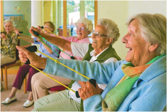 A group of elderly women do stretching exercises with resistance bands. Staying active is important for older adults, helping to make daily tasks easier to perform.