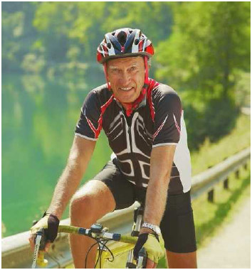 A senior enjoying a workout on his roadbike. Cardiorespiratory and muscular fitness are important aspects of an individual's life.