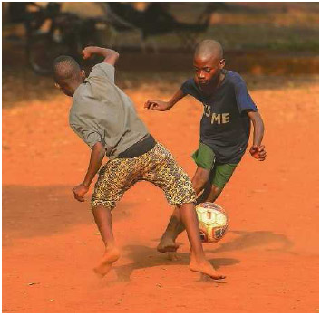 Beninese children play a game of soccer in Bohicon, Benin, January 2017. Soccer is a sport that can be played virtually anywhere because it requires very little equipment besides a ball and some sort of goaltender's net or area to defend.