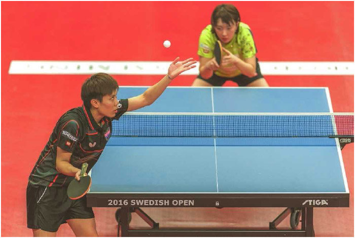 I-Ching Cheng of Chinese Taipei serves the ball to Hyowon Suh of South Korea during the 2016 International Table Tennis Federation Swedish Open in Stockholm, November 2016.
