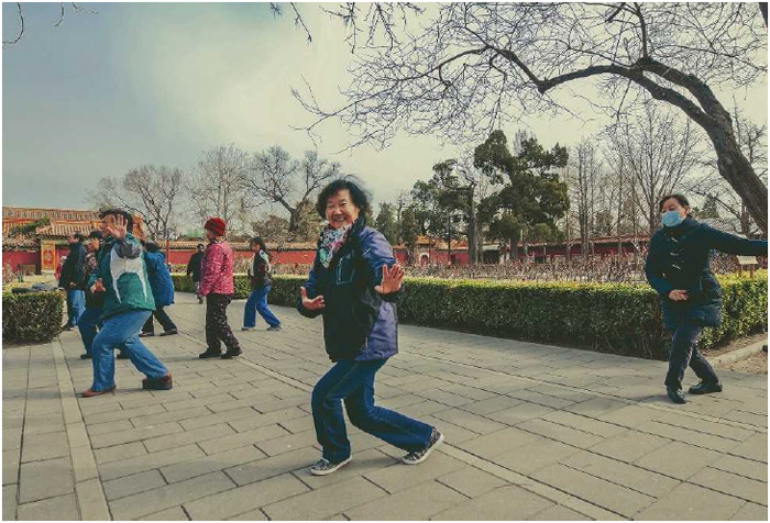 A group of men and women in Beijing, China, practice T'ai chi in a park, March 2013. While t'ai chi is a self-defense method in its most advanced form, it is widely practiced for its health and relaxation benefits.
