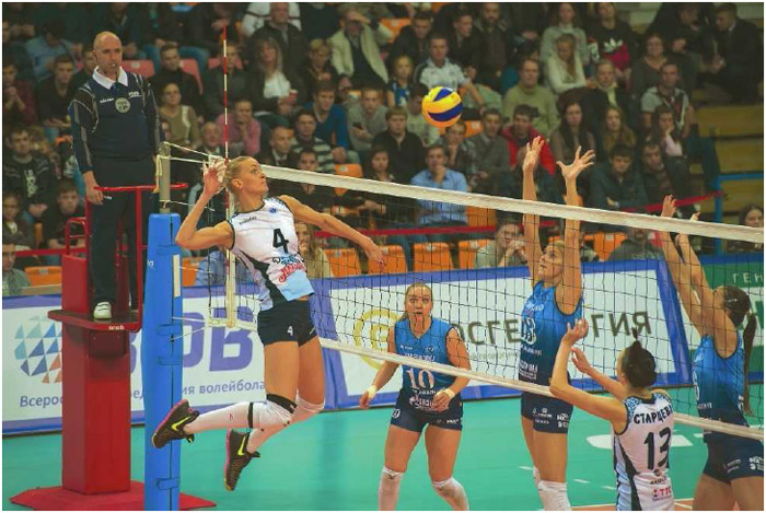 A player for the Russian team Dinamo-Kazan prepares to spike the ball to the waiting Dynamo Moscow team during a Superleague matchup in Moscow, Russia, November 2016.