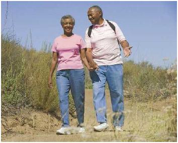 A senior couple enjoys a walk outside.