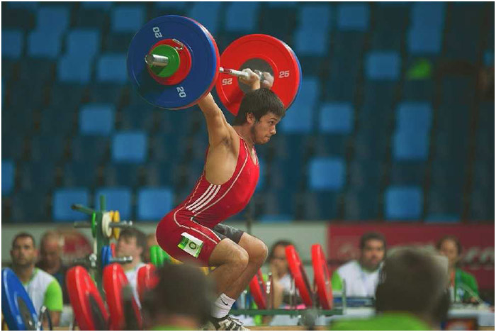 Eduardo Soto Montecino of Chile at an Olympics weightlifting event in Rio de Janeiro, Brazil, April 2016. The purpose of such competitions is to complete a maximum-weight lift of a barbell that is loaded with weight plates.