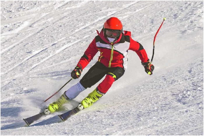 A skier shifts his body weight to change direction on the slopes. Alpine, or downhill, skiing is one of the most popular winter sports in the United States and is enjoyed by children and adults alike.