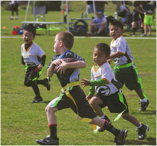 A team of five- and six-year-old boys play a game of flag football in Flagstaff, Arizona, May 2016. Youth sports allow children to begin learning the skills and techniques that will be needed at higher competetive levels.