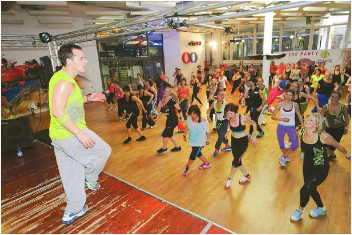 A Zumba instructor in Lugano, Switzerland, leads his class in a fun dance, November 2013. Zumba is a form of aerobic dance exercise that originated in Colombia in the late 1990s.