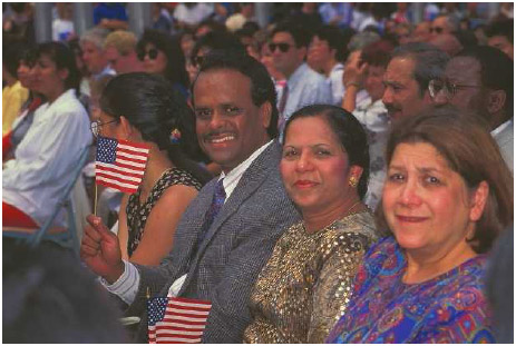 Indian immigrant couple becoming U.S. citizens. Immigrants who successfully earn citizenship often celebrate at their naturalization ceremonies, where they take the Oath of Allegiance to the United States.
