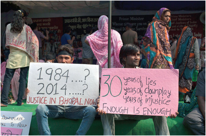 Bhopal gas tragedy survivors hold placards during a protest in New Delhi, India, Monday, Nov. 10, 2014.