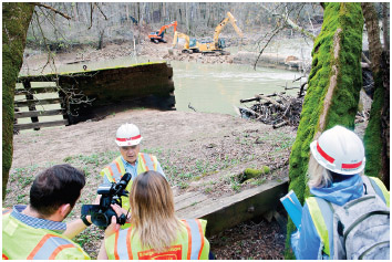U.S. Army Corps of Engineers project manager speaks with reporters Tuesday, March 28, 2017, as demolition of Green River Dam 6 continues in Brownsville, KY.