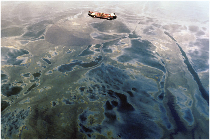 Exxon Valdez Surrounded by spilled oil, July 4, 1989 in Green Island, Prince William Sound, Alaska.