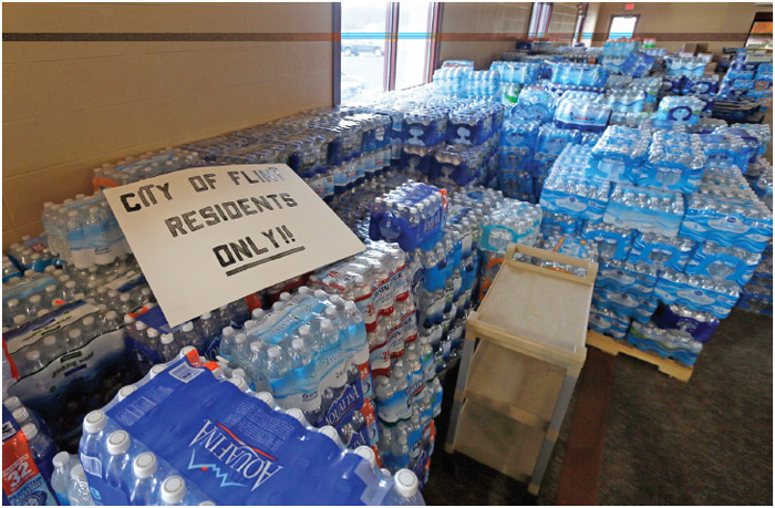Hundreds of cases of bottled water are stored at a church in Flint, Michigan.