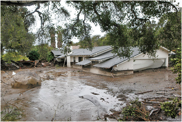 A house destroyed from flash flooding and debris along Olive Mill Road in Montecito, Calif. Heavy rain brought flash flooding and and mudslides to the area in Montecito, Calif. late on Tuesday, January 9, 2018.
