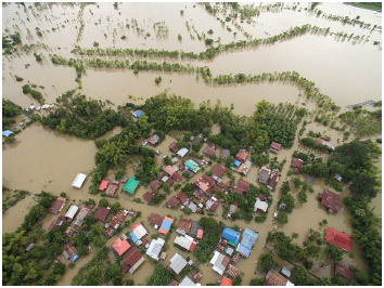 On August 3, 2017, flood waters overtake a house and rice field in northeast of Thailand.