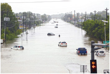 Vehicles stranded in flood waters in Houston, Texas, August 27, 2017. Widespread flood conditions prompted the closure of nearly every major road in Houston as Hurricane Harvey swept through.