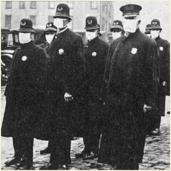 Seattle police wearing protective masks during the influenza pandemic of 1918–19, in which 20 million people died. Historical and epidemiological data are inadequate to identify the geographic origin.