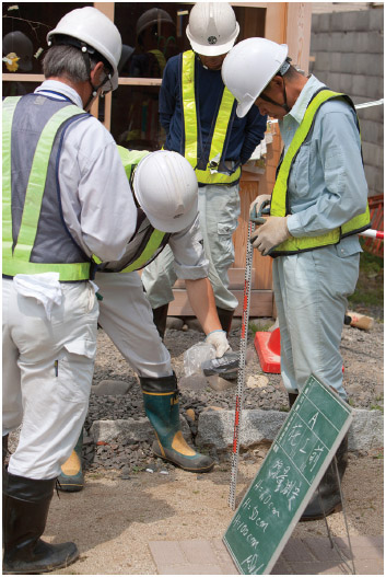 A team of local authority workers undertake radiation contamination monitoring in the grounds of Soramame Children's Nursery, in Fukushima city, in Fukushima prefecture, Japan, on Tuesday 7th June 2011.