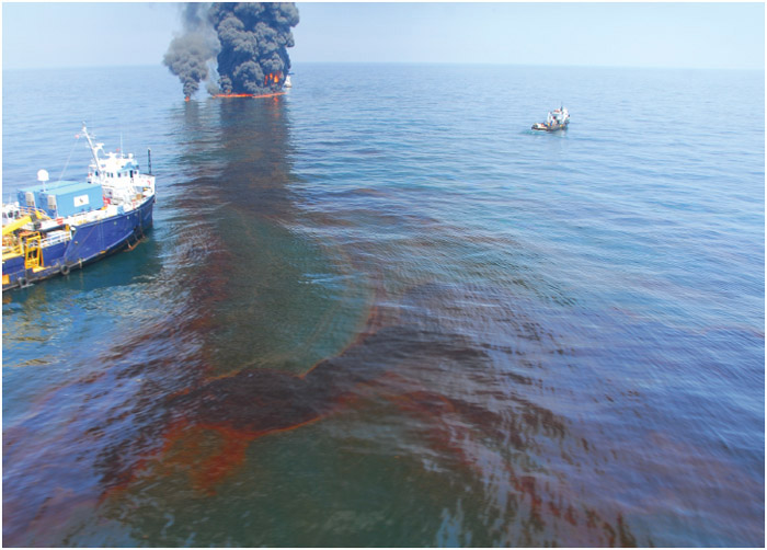 The controlled burn of spilled oil from the Deepwater Horizon/BP oil spill in the Gulf of Mexico.