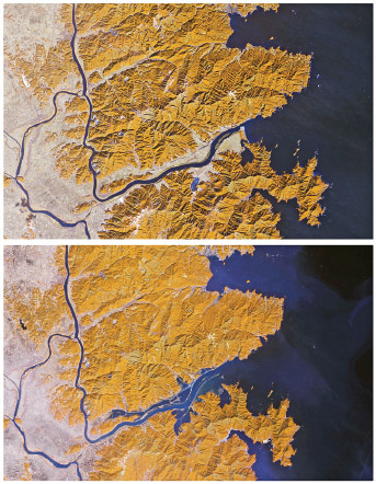Color-enhanced satellite image of Japan's Kitakami River before (top) and three days after (bottom) the devastating earthquake and tsunami of March 11, 2011.