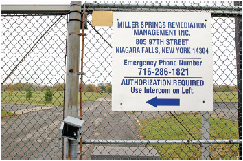 A locked gate secures the perimeter to the Love Canal site in Niagara Falls, N.Y., Oct. 25, 2004.