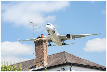 The newly developed Airbus A350 on landing approach over residential homes close to Farnborough Airport, UK on July 14, 2014.