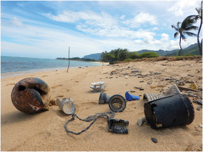 High surf and strong winds wash up various plastic marine debris at Hau'ula Beach Park, Oahu, Hawaii, March 10, 2018.