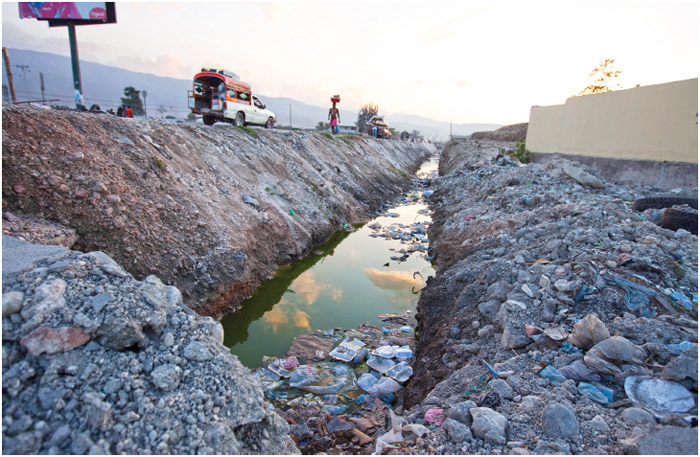 Waterway in Port-au-Prince, Haiti full of garbage. Haiti has little sanitation which is a factor in the spreading of the cholera epidemic.