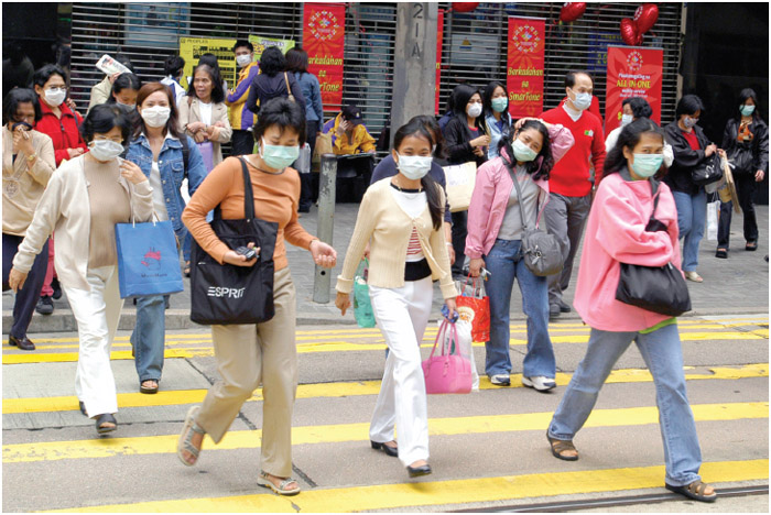 During the SARS outbreak in Hong Kong in 2003, people wore masks to inhibit the spread of the disease.