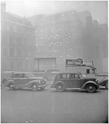 Morning traffic at Blackfriars, London, almost at a standstill because of the blanket smog in 1952.