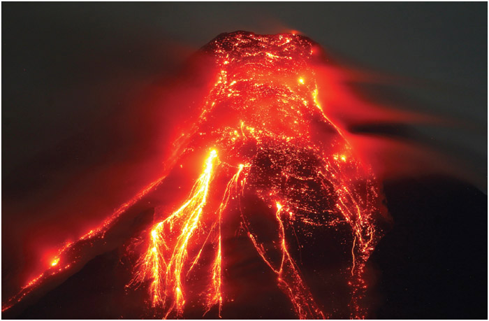 On Thursday, January 25, 2018, the Mayon volcano spews molten lava during its sporadic eruption in the early morning outside Legazpi city, Albay province, around 340 kilometers (200 miles) southeast of Manila, Philippines.