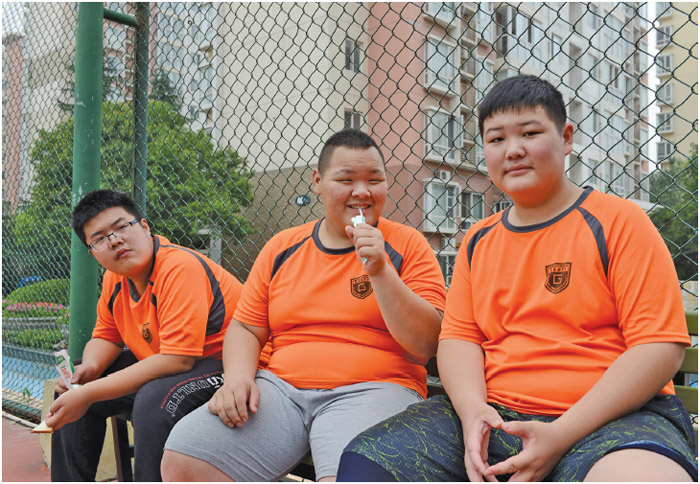 Overweight and obese students at a summer camp in Zhengzhou city, China. Obesity has particularly affected adolescents above the age of 12.