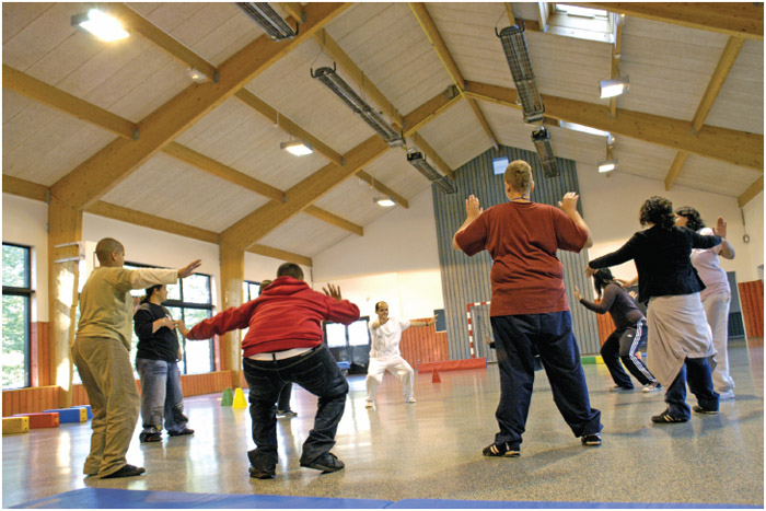 Teenagers taking part in a fitness class at at a hospital specialising in obesity treatment.