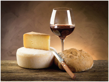 The French paradox refers to the low instance of obesity in France even though traditional meals inlcude foods like wine, bread, and cheese.