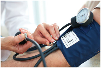 A doctor checks a patient's blood pressure levels.