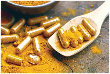 Turmeric supplement capsules and powder.