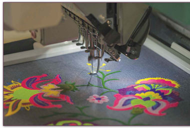 High-tech sewing machines, such as the one in this photo, can be used not only to sew pieces of fabric together, but also to embroider or add other decoration to cloth projects.