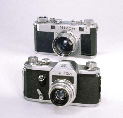 The Contax S 35-millimetre SLR camera (1949-51), front, was the first postwar SLR to incorporate a pentaprism. The Nikon S 36-millimetre SLR camera (1951-55), back, featured range finder focusing.
