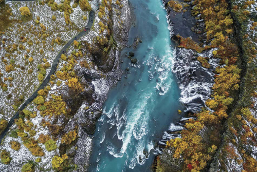 An aerial photograph of Hraunfossar Waterfalls in Iceland was taken using a drone. Cutting-edge technology is making aerial photography readily accessible to greater numbers of photographers.