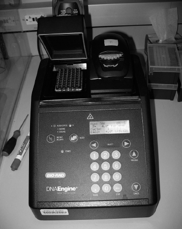 A PCR machine is responsible for reading DNA code and replicating the code to make many copies through a series of very specific chemical reactions. Public domain, via Wikimedia Commons.