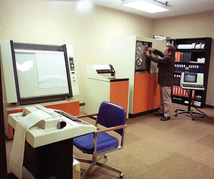 Located at Chambersburg, Pennsylvania. A view of the Computer Aided Design/Computer Aided Manufacturing (CAD/CAM) system central processing facility and graphic plotter at Letterkenny Army Depot.